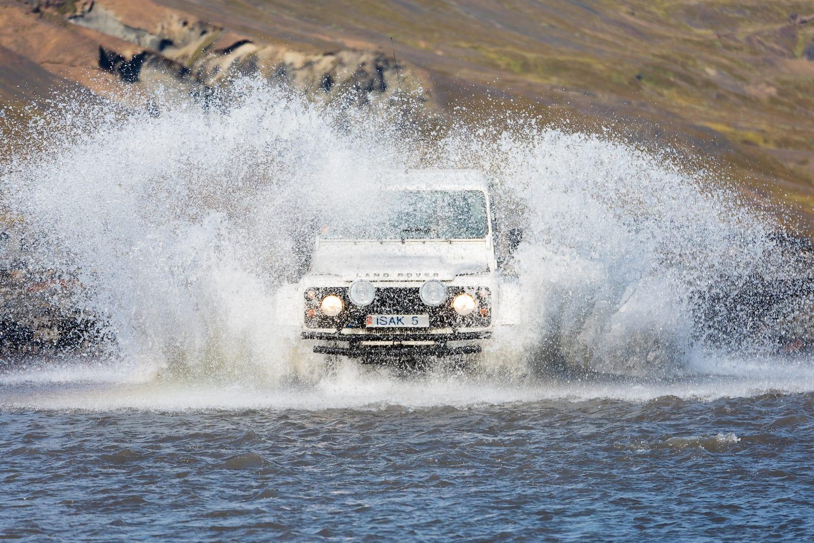 Superjeep crossing a river