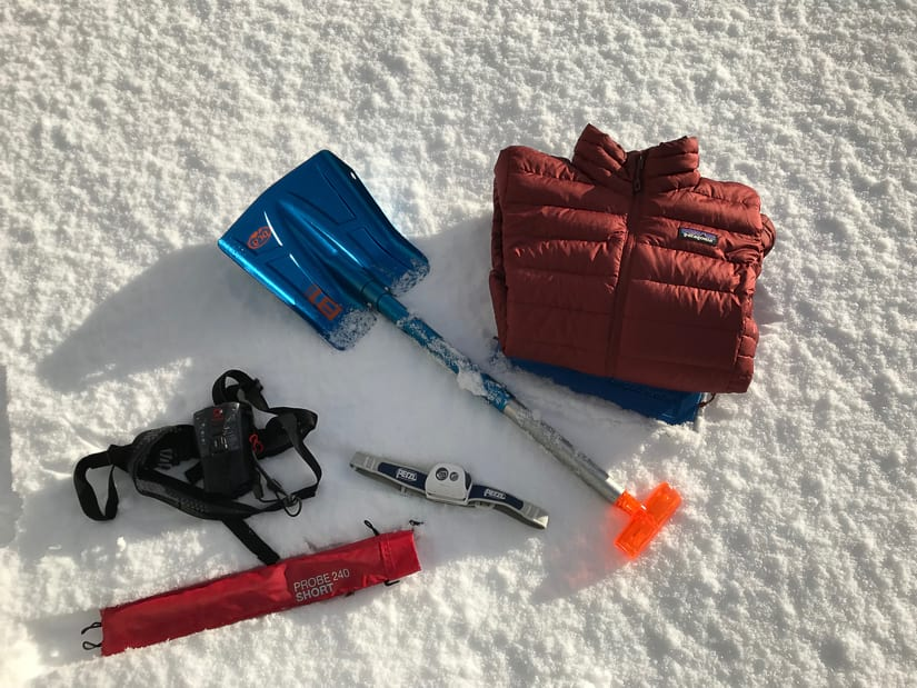 Essential winter gear: Transceiver, shovel, beacon, headlight, down jacket