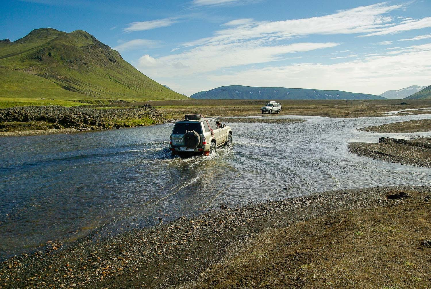 Superjeeps crossing rivers in Landmannalaugar