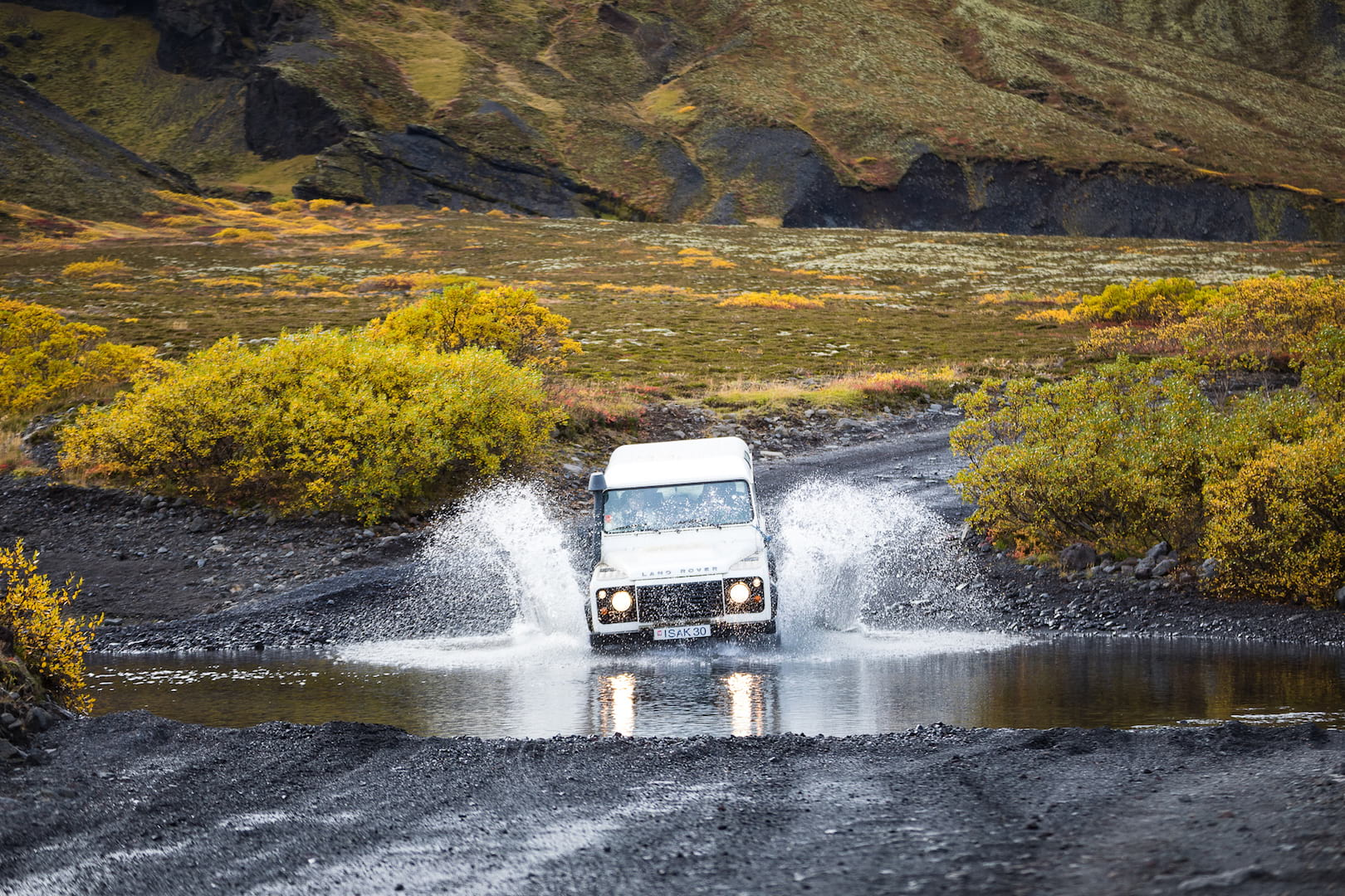 Adventurous river crossing by a white SupetJeep in Landmannalaugar, Iceland