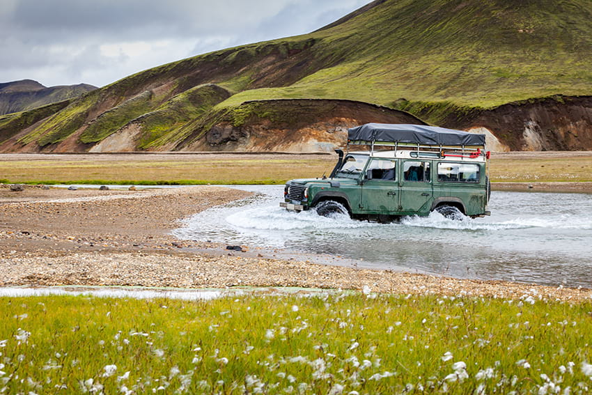 Jeep crossing unbridged river in Landmannalaugar, Iceland